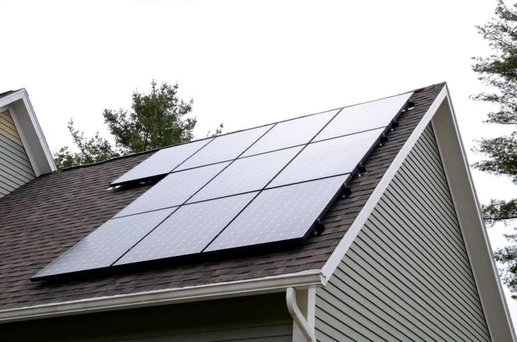 Black solar panels installed on a roof