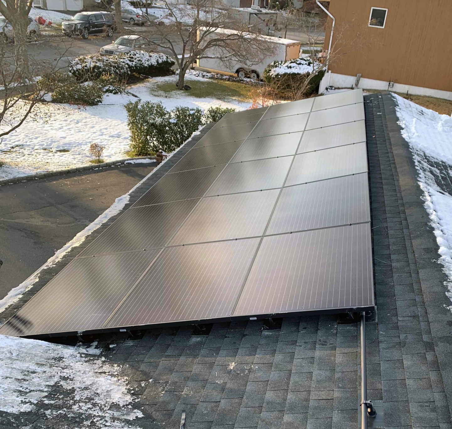 solar home roof with snow